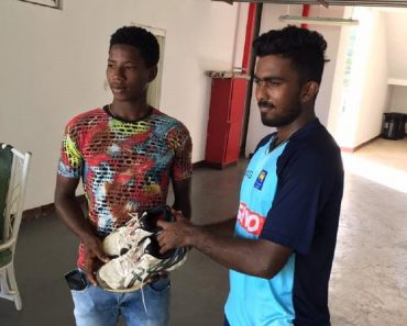 AsithaFernando giving his shoes to another Jamaika cricketer