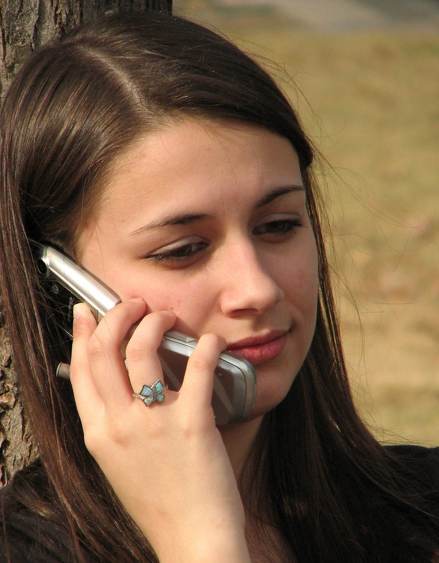 teenage-girl-talking-on-a-cell-phone-